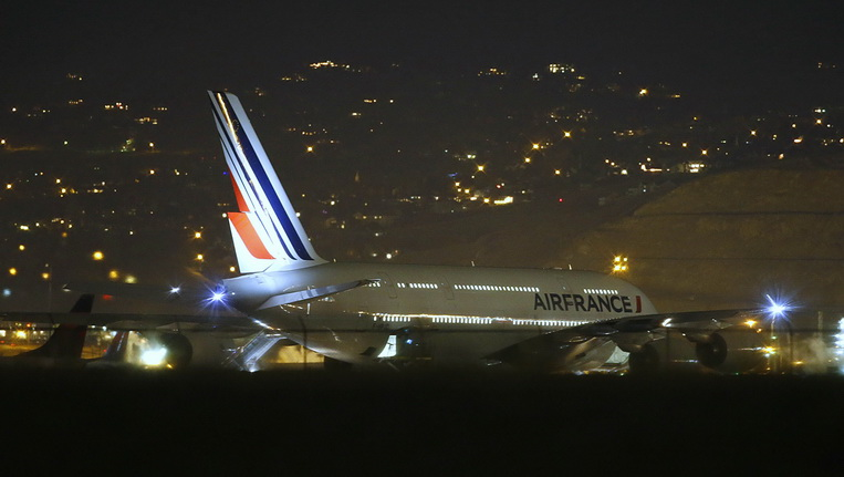 "Air France Airbus 380, Flight 65, sits on the runway at the Salt Lake City International Airport being inspected by the FBI on November 17, 2015 in Salt LAke City, Utah. Two Air France flights bound for Paris from the United States were diverted November 17, 2015 and landed safely after the airline received anonymous bomb threats, the carrier said. Flight 65 from Los Angeles and Flight 55 from Washington were ""subject to anonymous threats received after their respective takeoff,"" the airline said in a statement. AFP PHOTO / GEORGE FREY"