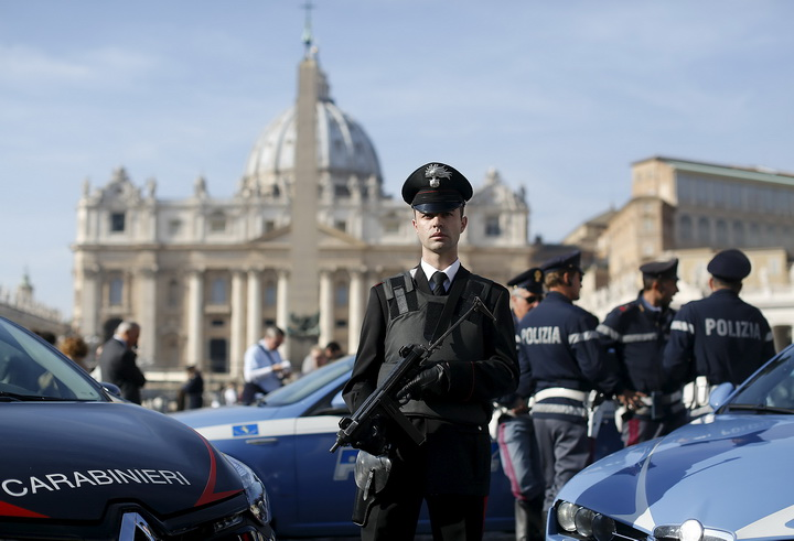 An Italian Carabinieri officer stands guard in front of Saint Peter's Basilica in Rome