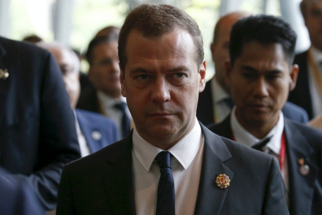Russian Prime Minister Dmitry Medvedev leaves the East Asia Summit meeting in Kuala Lumpur
