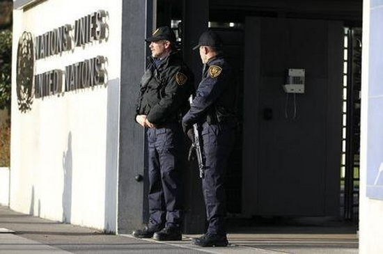 United Nations security officers stand guard outside the U.N. European headquarters in Geneva, Switzerland, December 10, 2015. REUTERS/Pierre Albouy