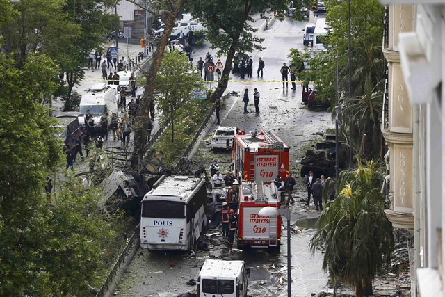 Fire engines stand beside a Turkish oplice bus which awas targeted in a bomb attack in a central Istanbul district, Turkey, June 7, 2016. REUTERS/Osman Orsal TPX IMAGES OF THE DAY