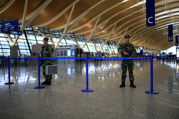 Paramilitary policemen guard near the site of a blast at a terminal in Shanghai's Pudong International Airport, China, June 12, 2016. REUTERS/Aly Song