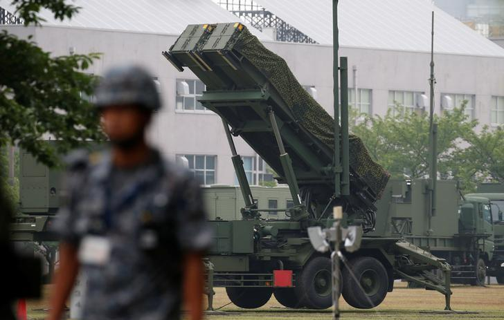 A Japan Self-Defense Forces soldier guards near a unit of Patriot Advanced Capability-3 (PAC-3) missiles at the Defense Ministry in Tokyo, Japan June 22, 2016.    REUTERS/Toru Hanai