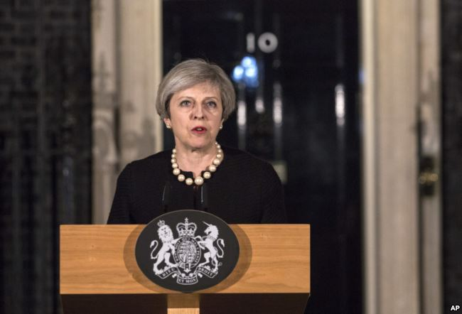 Prime Minister Theresa May makes a statement in Downing street following the terrorist incident in westminster.